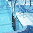 Pool ladder in water — Stock Photo