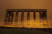 Sparking fire rings on National Monument, Edinburgh, Scotland. — Stock Photo
