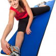 Young fit woman exercising — Stock Photo