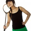 Young Asian woman with a badminton racket — Stock Photo #17663257