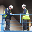 Постер, плакат: Foreman and construction worker at constraction site