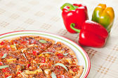 Crusty cooked pizza — Stock Photo