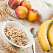 Bowl of muesli for breakfast with fruits — Stock Photo