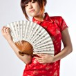 Chinese model in traditional Cheongsam dress — Stock Photo #23639421