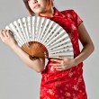 Chinese model in traditional Cheongsam dress — Stock Photo #23639663