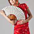 Chinese model in traditionele cheongsam jurk — Stockfoto #23639663