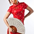 Chinese model in traditional Cheongsam dress — Stock Photo