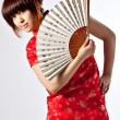 Chinese model in traditional Cheongsam dress — Stock Photo #23640247