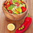 Wooden bowl with salad — Stok fotoğraf
