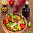 Wooden bowl with salad — Stock Photo #26901677