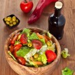Wooden bowl with salad — Stock Photo #26901883