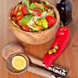 Wooden bowl with salad — Stock Photo