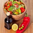 Wooden bowl with salad — Stock Photo #26902089