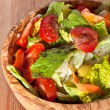 Wooden bowl with salad — Stock Photo #26902221