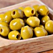 Green pitted marinated olives — Stock Photo