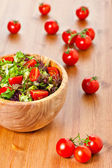 Mixed lettuce salad and tomatoes — Stock Photo