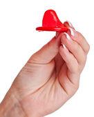 Hand holding a condom — Stock Photo