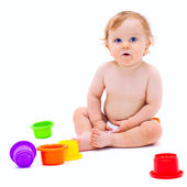 Cute infant boy with toys — Stock Photo