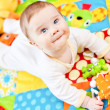 Infant boy on playmat — Stock Photo