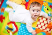 Infant boy on playmat — Stock Photo