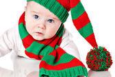 Barnet med jul mössa och halsduk — Stockfoto