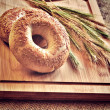 Bagels on bread board — Stock Photo