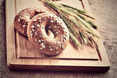 Bagels on bread board — Stock Photo