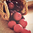 Plumms scattered from wicker basket — Stock Photo