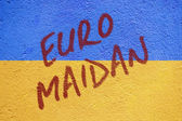 Ukraine flag painted on old concrete wall with EURO MAIDAN inscr — Stock Photo