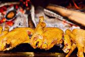 Chicken roasting on skewer — Stock Photo