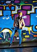 Pretty young girl and graffiti — Stock Photo