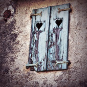 Wooden window shutters with heart shape — Stock Photo