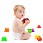 Cute infant boy with apple — Stock Photo