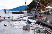Destroyed piers with boats in Verbania — Stock Photo
