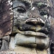 Stock Photo: Giant face at Bayon Temple, Cambodia