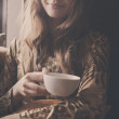 A young beautiful girl with a cup of tea — Stock Photo