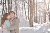 Outdoor happy couple in love, waiting for spring in cold weather — Stock Photo
