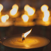 Burning candles in the monastery — Stockfoto