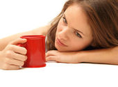 Young beautiful girl with red mug — Stock Photo