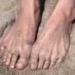 Two legs in the shallow shining sand — Stock Photo