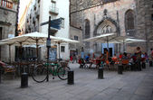 Cafe on the square in Barcelona in the summer tourists — Stock Photo