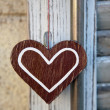 Stock Photo: Artifact in form of heart on background of wooden shutte