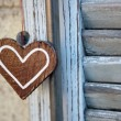 Stock Photo: Artifact in form of heart, on wooden shutters background