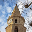 Clock tower on a background of blue sky with clouds — Stock Photo #20126403