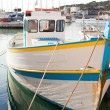 Old white motor boat at the dock in Cassis - Stock Photo