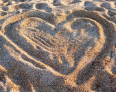 Heart on the sand at the beach — Stock Photo