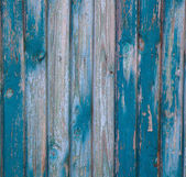 Texture of a wooden vintage fence painted blue paint — Stock Photo