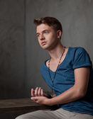 Young man in a blue shirt — Stock Photo