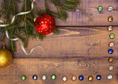 Christmas frame on a wooden background — Stock Photo