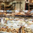 Showcase at the French bakery in paris — Stock Photo